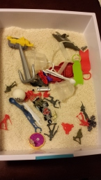 Small toys, measuring spoons, small tupperware containers, etc.